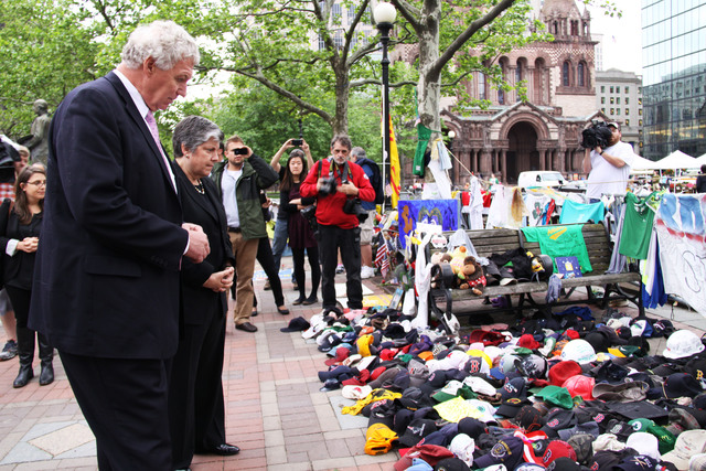 Boston, Mass., May 24, 2013 -- Department of Homeland Security Secretary Janet Napolitano and FEMA Deputy Administrator Rich Serino pay their respects at the Boston Marathon Bombing Memorial in Boston's Copley Square