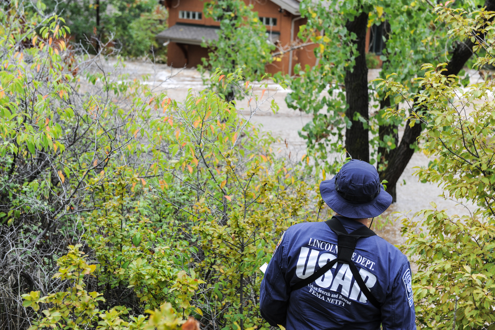 Boulder, Colo., Sep. 16, 2013 -- FEMA's Urban Search and Rescue (USAR) conduct door to door checks in left hand canyon Photo by Michael Rieger/FEMA