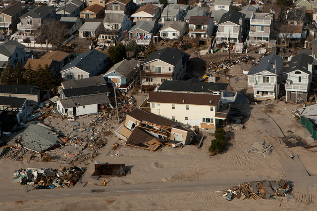 Breezy Point, N.Y., Nov. 12, 2012 -- Aerial view of homes destroyed by Hurricane Sandy in the Breezy Point neighborhood on the New York coastline. The waves and surge damaged and destroyed thousands of homes on the Eastern coast. Andrea Booher/FEMA