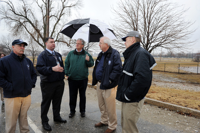 Bridgeport, Conn., Nov. 27, 2012 -- FEMA Administrator Craig Fugate, second from right,  talks to local, state and federal  officials during a tour of a neighborhood  impacted by Hurricane Sandy.  The Administrator also visited local Disaster Recovery Centers through out the area.  Jocelyn Augustino/FEMA