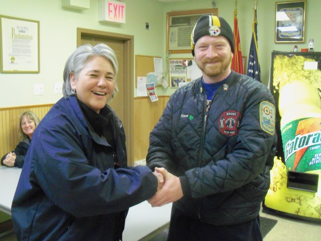 Bronx, N.Y., Nov. 10, 2012 -- Kathy Fields, FEMA Division Supervisor for the Bronx presented a donation of $350.00 and a $25.00 Dunkin' Donut's gift card to Andrew Keane, Assistant Fire Chief for the Edgewater Volunteer Fire Department, as an extra ΓÇ£Thank YouΓÇ¥ to the volunteer firemen and their community.  The Edgewater Volunteer Fire Department lent their station house as a Disaster Recovery Center, to help those they serve in their community as well as others in the Bronx that would make their way to the FEMA Disaster Recovery Center for assistance.  The station house also served as warm place of refuge for Community Relations teams walking out in the elements to ensure that the residents of the Bronx knew how to register for FEMA assistance and where to go for help