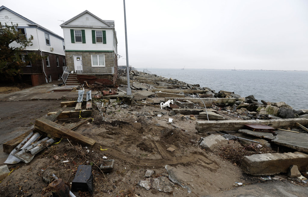 Brooklyn, N.Y., Dec. 8, 2012 -- Debris from Hurricane Sandy litters the beach in Brooklyn, N.Y. FEMA is working with various partners including federal, state local and tribal governments, voluntary faith-based and community-based organizations, along with the private sector, to assist residents impacted by Hurricane Sandy. Chris Kleponis/FEMA