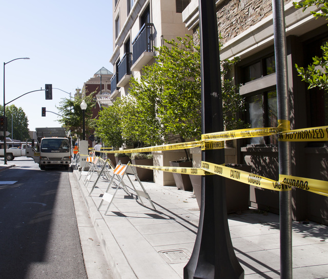 Caution tape keeps pedestrians and cars at a safe distance from damaged buildings on the streets of downtown Napa, California, after a 6.0 earthquake rocked the city on August 24th, 2014