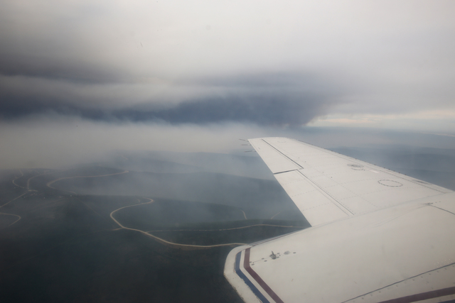 Census Area, Alaska, July 7, 2013 -- Black Smoke Billows in the distance from the Stuart Creek Fire no. 2, firefighters are fighting the fast burning blaze on the ground as FEMA task force teams fly above en route to flooding inspections along the Yukon river. Adam DuBrowa/FEMA