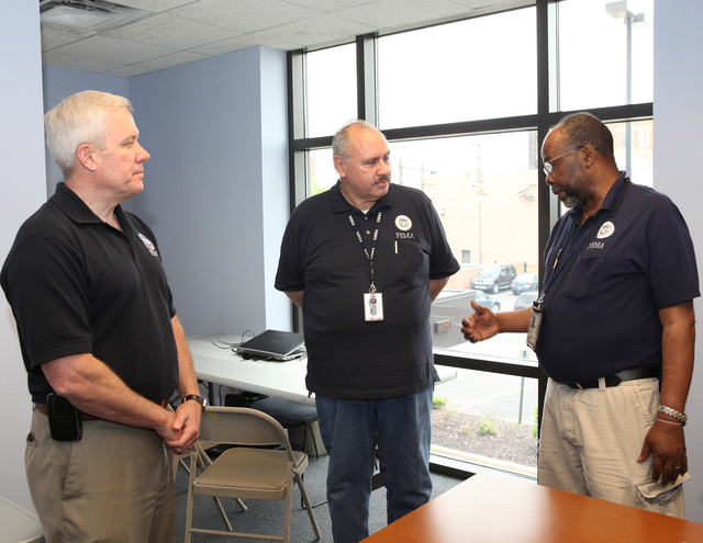 Chicago, Ill., May 31, 2013 -- FEMA Federal Coordinating Officer Michael Moore [L] meets with Disaster Recovery Center (DRC) Manager Jose Buttera [c] and Applicant Services Lead Erol Johnson [r] during his visit to the newest DRC located on the south side of Chicago.  FEMA is responding to wide spread flooding as a result of severe storms and straight-line winds that damaged or destroyed homes across Illinois during April and May 2013.  David Fine/FEMA