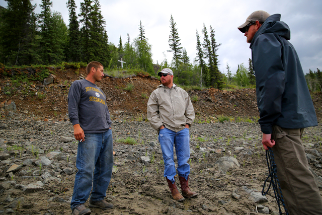 Circle, AK, July 16, 2014-- Tanana Tribal Logistics Specialist Jack Boyle (L), FEMA Logistics Specialists Brian Baker (C) and Chris Reese (R) visit an ancient sacred burial ground in the upper Yukon. As subsistence hunters and fisherman, FEMA funds recovery measures for the fishing and hunting camps damaged by severe flooding using Other Needs Assistance (ONA) because the community depends of subsistence living for their survival. Adam DuBrowa/ FEMA