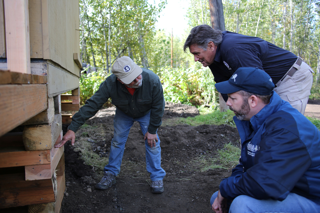 Circle, AK-- Mennonite Disaster Service Director John Eshleman (L) points out the elevation of this replacement home after the disaster survivor decided to elevate up to higher ground away from the repetitive flooding areas.  The homeowners opted to move out of harms way and mitigate the loss of life and property with a FEMA grant and utilize the volunteer labor coordinated by FEMA with Mennonite Disaster Services for rebuilding. Adam DuBrowa/ FEMA
