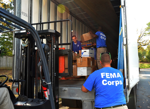 Clinton, Miss., Oct. 4, 2012 -- FEMA Corps members reload FEMA trailors with freshly packed supplies and materials returned from disaster recovery centers throughout Mississippi.  FEMA is helping survivors recover and clean up after Hurricane Isaac damaged or destroyed homes and businesses across Mississippi and Louisiana.  David Fine/FEMA