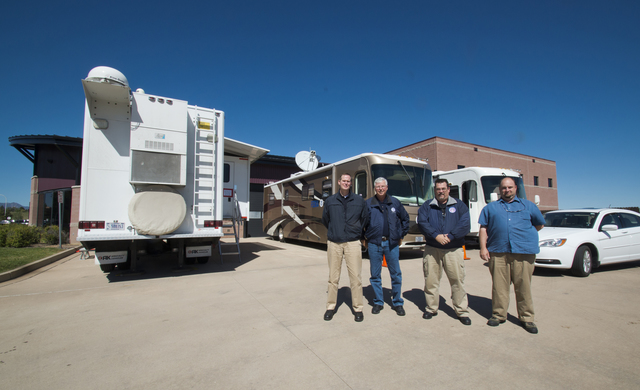 Colorado Springs, CO September 24, 2013 -- Members of the Mobile Emergency Response group stand in front of some of the trucks used by FEMA to provide various forms of communications services.  From left to right, William Watrel, Branch III Director, John Bondurant, Division Supervisor and Paul L. Elder, Colorado South Central Region Field Manager. FEMA is working with local, state and other federal agencies to provide assistance to residents, businesses and communities affected by the recent floods.  Photo by Patsy Lynch/FEMA