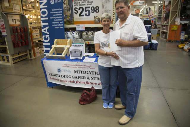 Conway, AR, May 27, 2014 – At a Home Depot in Conway, Arkansas, Joe and Rose Freeman smile for the camera as they obtain FEMA Mitigation information on building a safe room for their home in Quitman, Arkansas in response to the severe storms and tornado that struck Arkansas on April 27. FEMA Mitigation techniques and methodology are an important component of the recovery strategy that FEMA shares with local, state and tribal governments following a natural disaster. Photo by Christopher Mardorf / FEMA