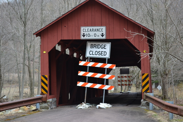 Davidson Township, Pa., April 14, 2013 -- A sign stops traffic from crossing through the covered bridge over Muncy Creek on Champion Hill Road. FEMA funds will cover75 percent of the $397,656 it will cost to rebuild the 163-year-old bridge, which was nearly completely destroyed by Tropical Storm Lee and Hurricane Sandy in 2011