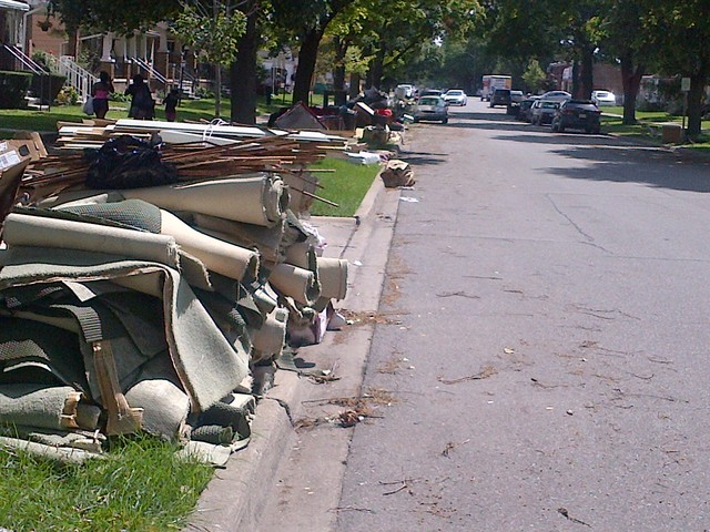 Dearborn, Mich., August 27, 2014 -- Destroyed household items and ruined carpeting is placed curbside ready for disposal crews to pick up in Dearborn, Michigan after the flood event of August 14, 2014