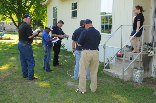 Dewar, Okla., June 10, 2013 -- FEMA Individual Assistance Specialist John Nelson, Oklahoma Emergency Management Area Coordinator Chuck Kerns, Small Business Administration Loss Verifier Ahmed Hossain FEMA Hazard Mitigation Specialist Lon Conner, and Dewar Police Chief Steve Watkins are conducting a joint federal, state, local Private Property Preliminary Damage Assessment (PPPDA) in Okmulgee County after damaging storms and flooding affected this area May 30 and 31. PPPDA's are a required procedure in support of the state's request for federal disaster assistance. George Armstrong/FEMA