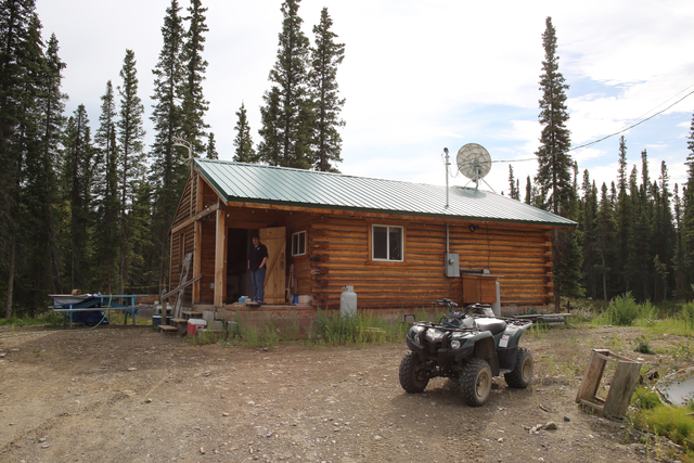 Eagle, Alaska, Aug. 7, 2013 -- Disaster Survivor Mary David's home was relocated from the banks of the Yukon River to higher ground with the assistance of the FEMA mitigation programs. Innovative partnerships and programs with the State and the residents successfully relocated this home. Adam DuBrowa/ FEMA