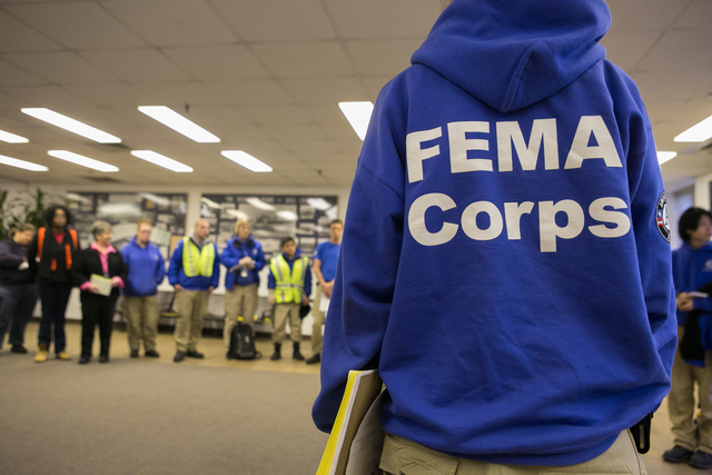 East Farmingdale, N.Y., Nov. 19, 2012 -- FEMA Corps team assembles for their morning briefing at Farmingdale Airport. FEMA Corps team members are working to assist residents impacted by Hurricane Sandy. Photo by Chris Ragazzo/FEMA