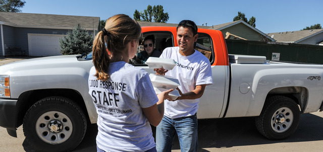 Evans, Colo., September 25, 2013 -- Mercy Chief hands out meals to Disaster response groups Hands.org, Christian Aid Ministries, Nechama, Muslims for Humanity and AmeriCorps as they join forces to help muck out homes in Evans. Photo by Michael Rieger/FEMA
