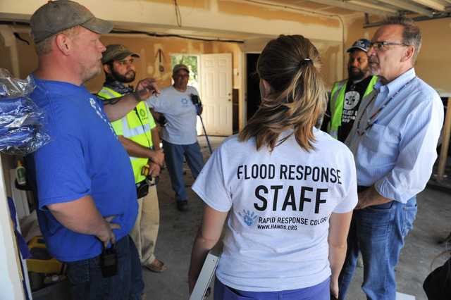 Evans, Colorado Septemeber 25, 2013 -- Rev. David Myers, Department of Homeland Security Center for Faith-based & Neighborhood Partnerships, talks with disaster response groups Hands.org, Christian Aid Ministries, Nechama, Muslims for Humanity and AmeriCorps who joined forces to help clean out homes in Evans. Photo by Michael Rieger/FEMA