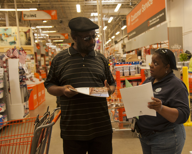 Fairfield, Ala., June 20, 2014 -- Pat Crawford, a FEMA Mitigation Community Education Outreach (OEC) specialist talks to a resident at a Lowe's Hardware store in Fairfield, AL.  FEMA is working with local businesses to provide information to residents who may have been affected by recent storms.  Patsy Lynch/FEMA