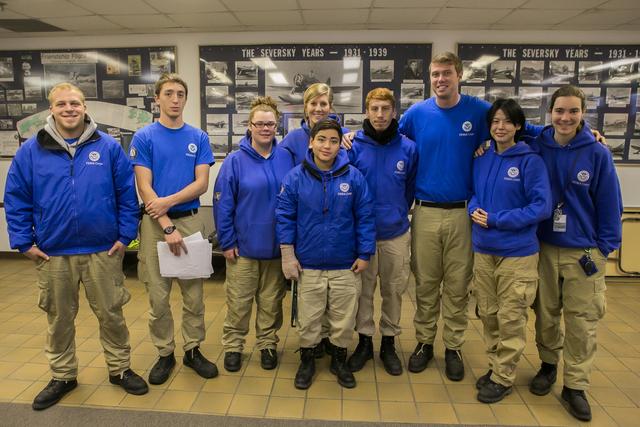 Farmingdale, N.Y., Nov. 19, 2012 -- FEMA Corps team assembles for the morning briefing at Farmingdale Airport. FEMA Corps teams are helping Sandy survivors across the East Coast. Chris Ragazzo/FEMA