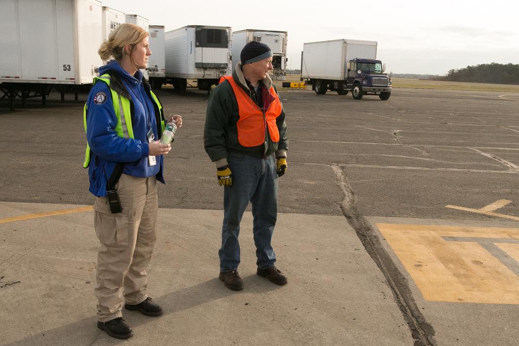 Farmingdale, N.Y., Nov. 19, 2012 -- FEMA Corps Team Member Morgan Blake directs tractor trailer traffic at the Farmingdale Airport. Chris Ragazzo/FEMA