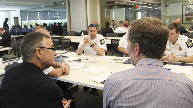 """""""FEMA Region I works in collaboration with state, local, and Canadian officials during a tabletop exercise in Massachusetts. This """"""""cross-border"""""""" exercise was designed to improve communication during an emergency or disaster that affects two or more states, and, in this case, Canada. """""""