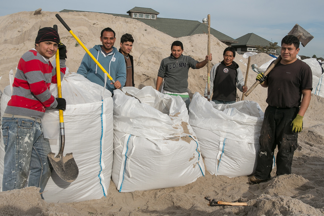 Fire Island, N.Y., Nov. 20, 2012 -- Workers on historic Fire Island fill over-sized sandbags to create a man-made protective sea wall. FEMA is working with state and local officials to assist residents who were affected by Hurricane Sandy. Chris Ragazzo/FEMA