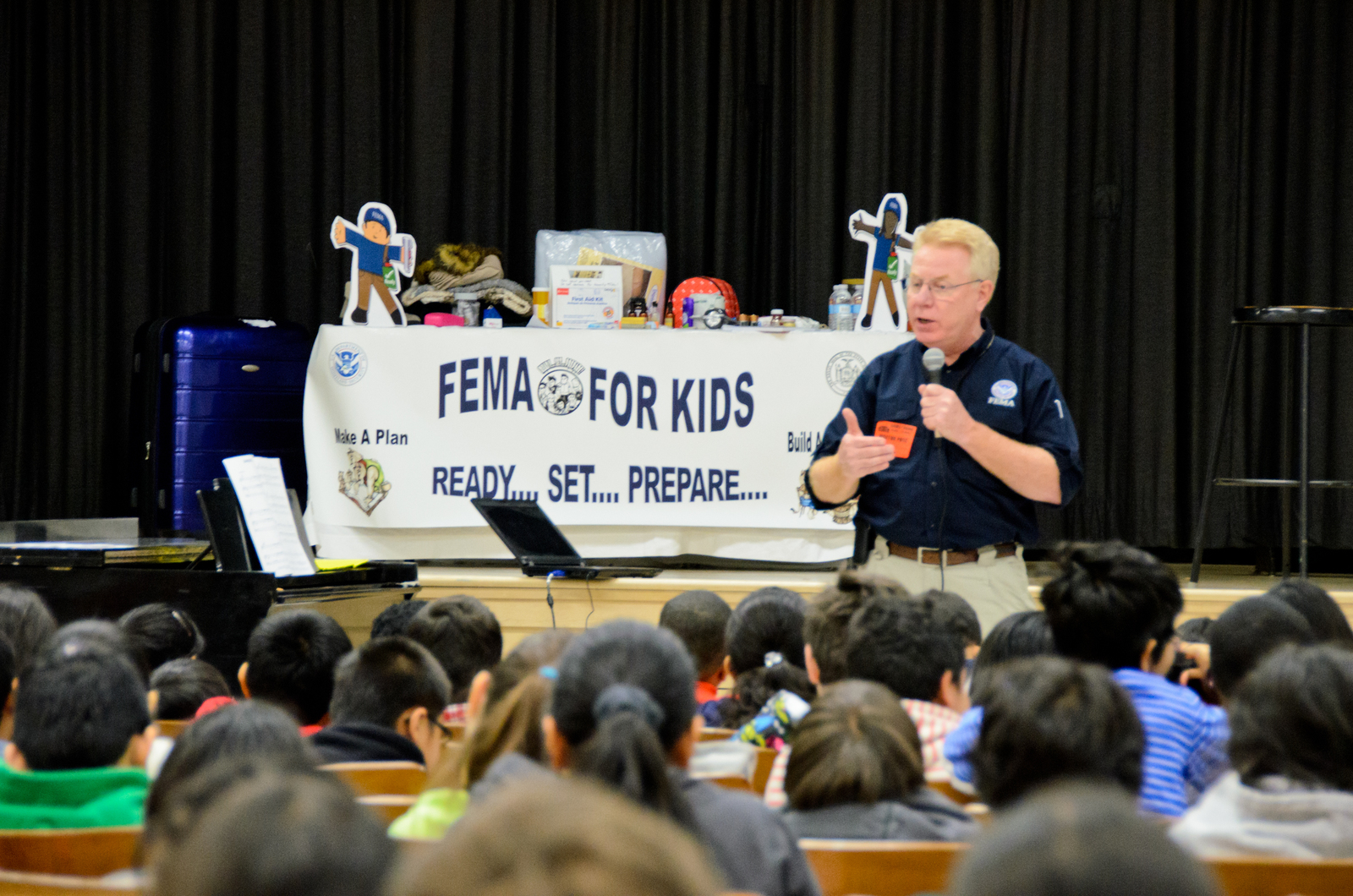 Flushing, N.Y., Feb. 1, 2013 -- FEMA Federal Coordinating Officer (FCO) Michael Byrne, gives an Emergency Management presentation to students and faculty at The Louis Armstrong Middle School - IS 227Q in Flushing, New York. Mr. Bryne shows a FEMA emergency response video and conducts a question and answer session, covering topics from the Hurricane Sandy response by FEMA, to what it was like working as a New York City Firefighter (FDNY) and growing up in New York with a family dedicated to public service. Andre R. Aragon/FEMA