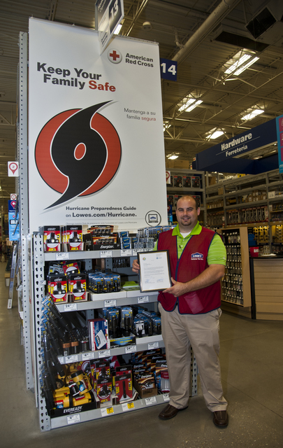 Foley, Ala., July 14, 2014 -- Bobby Roberts, Lowe Store Manager holds a Certficate of Appreciation given to the Foley, Ala. Lowe store by the FEMA Mitigation division for its assistance in providing FEMA with space in their store so that Mitigation and Individual Assistance specialists could provide residents with information they could use following the tornadoes and severe storms that swept through the area in early May. Patsy Lynch/FEMA