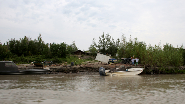 Fort Yukon, Alaska, July 6, 2013 -- FEMA inspectors arrive at the Fort Yukon village by boat to greet the Gadzow family who lost their Salmon Mills, Nets and key subsistence tools for harvesting the king salmon after severe flooding destoyed their way of fishing for food. FEMA has strong, long-standing relationships with Tribal governments, and they are essential members of the emergency management team. Adam DuBrowa/ FEMA
