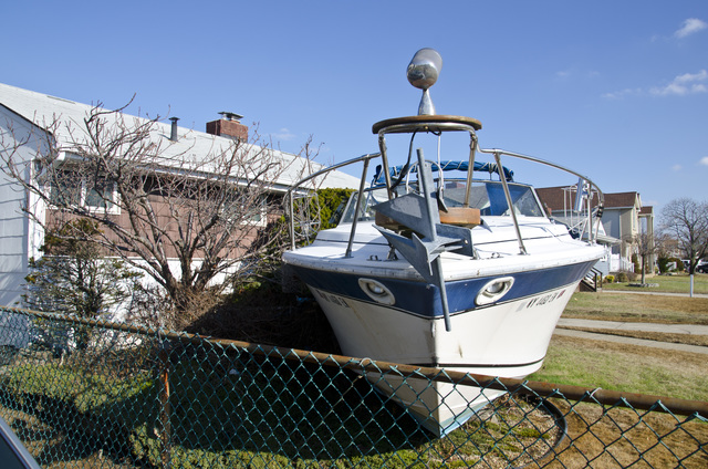 Freeport, N.Y., Dec. 13, 2012 -- Many boats floated ashore and wound up in unlikely places following Hurricane Sandy. FEMA is working with state and local officials to assist residents who were affected by Hurricane Sandy. Howard Greenblatt/FEMA