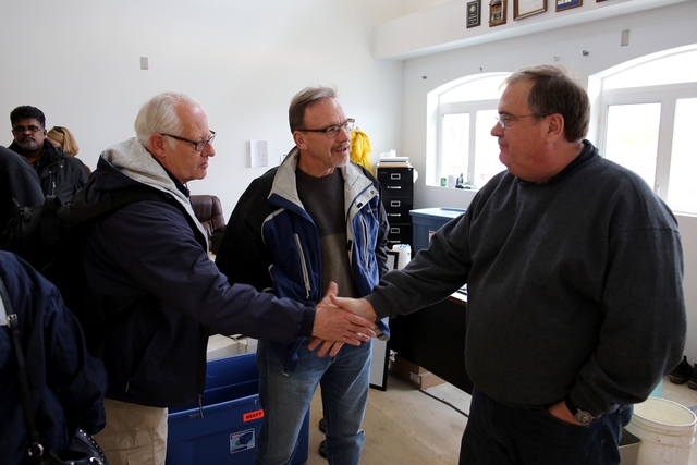 Galena, AK, September 8, 2013 -- FEMA Regional Administrator Ken Murphy (L) greets City Manager Greg Moyer (R) at the medical facility which was damaged by severe flooding. FEMA is working with their partners to get the city of Galena back on the road to recovery. Adam DuBrowa/ FEMA