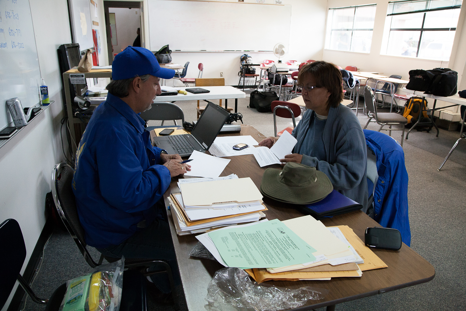 Galena, Alaska, July 1, 2013 -- Dave Walker, a Small Business Administration (SBA) specialist, assists business owner Marlene Marshal with technical details necessary for loan applications. The SBA provides survivors with business loans to help with the recovery process. Photo by Ed Edahl/FEMA