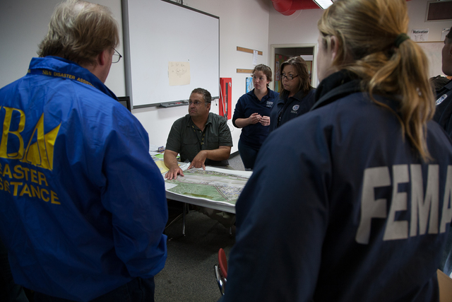 Galena, Alaska, July 1, 2013 -- John Fulton, a FEMA lead, briefs teams of FEMA specialists as they prepare to bring assistance to citizens of Galena. FEMA has a variety of disaster aid services  which are managed by specialists in the field. Photo by Ed Edahl/FEMA