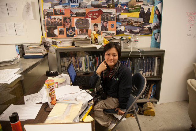 Galena, Alaska, July 2, 2013 -- Shelly Kunishige, a public information officer on loan from the state of Hawaii, works in a make-shift office  in the Galena airport. FEMA personnel often have to improvise to do their work. Photo by Ed Edahl/FEMA