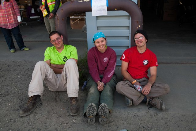 Galena, Alaska, July 23, 2013 -- Ryan Elliott, Erica Redzinak and Henry Moss relax before getting their day's marching orders. AmeriCorps teams can have big impacts on disaster recoveries with their contributions of skilled labor. Photo by Ed Edahl/FEMA