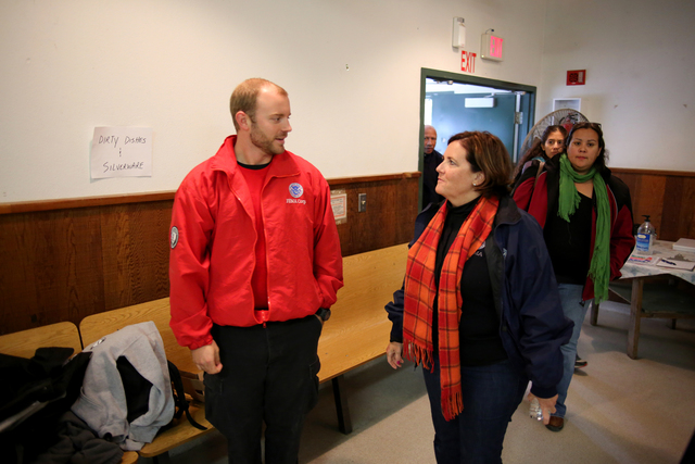 Galena, Alaska, Sep. 9, 2013 -- FEMA Deputy Associate Administrator, Response and Recovery, Elizabeth Zimmerman greets a FEMA Corps manager at the local community center. The community center serves as a food distribution center where disaster survivors can get a hot meal as well as the latest disaster recovery information. Adam DuBrowa/ FEMA