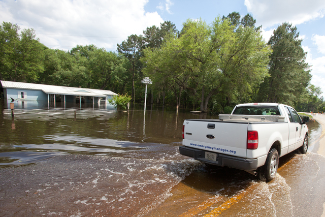 Grand Ridge, FL, May 13, 2014--Jackson County Emergency Manager drives through flooded area in Grand Ridge to check on residents of the county. Andrea Booher/FEMA