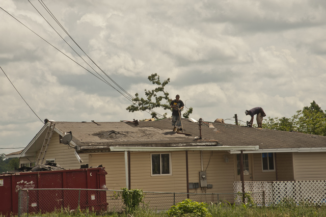 Graysville, Ala., June 13, 2014 -- Roofers work on a  damaged home in Graysville, Ala. FEMA is providing assistance to residents who sustained damage in eligible counties. Patsy Lynch/FEMA
