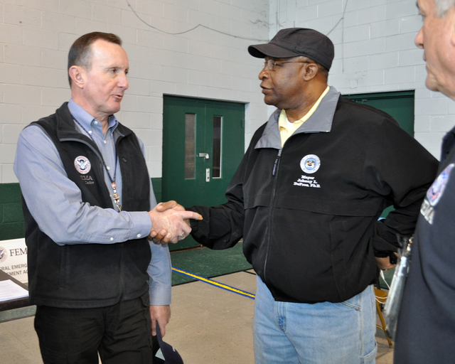 Hattiesburg, Miss., Feb. 16, 2013 -- Federal Coordinating Officer (FCO) Terry Quarles introduces himself to Hattiesburg Mayor Johnny Dupree as the Disaster Recovery Center (DRC)  in Forrest County.  FEMA and officials of the State of Mississippi are working closely together to meet the needs of tornado survivors.  Photo by Marilee Caliendo/FEMA