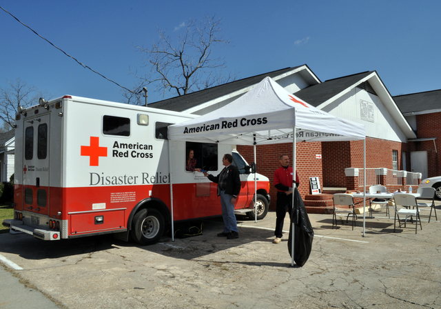Hattiesburg, Miss., March 1, 2013 -- This Red Cross van is parked at the First Trinity Baptist Church on Mobile Street, handing out snacks and other small items to local residents. American Red Cross volunteers are positioning their trucks in locations where they can provide food and supplies to workers and disaster survivors.  Photo by Marilee Caliendo/FEMA