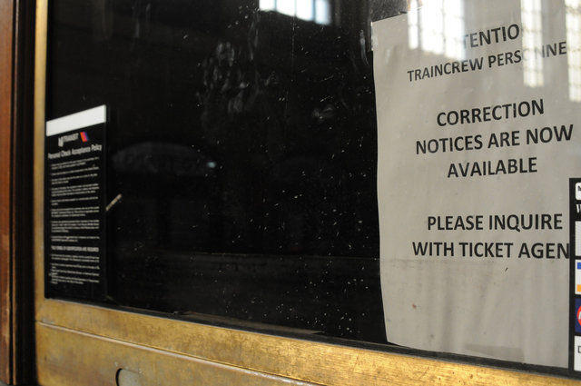Hoboken, N.J., Nov. 23, 2012 -- At the New Jersey Transit Terminal Ticket Office, the flood water level can be faintly seen below the last line of this notice in the window, a distance of more than three feet. Extensive damage here resulted from Hurricane Sandy and FEMA Public Assistance funds may pay a portion of recovery cost. George Armstrong/FEMA