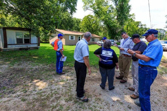 Holister, Mo., Aug. 15, 2013 -- After flooding in Southern Missouri, a Preliminary Damage Assessment (PDA) team consisting of representatives of FEMA, State and local officials inspect an area effected by flooding. PDA is a joint assessment used to determine the magnitude and impact of an event's damage. The State uses the results of the PDA to determine if the situation is beyond the combined capabilities of the State and local resources and to verify the need for supplemental Federal assistance. Steve Zumwalt/FEMA