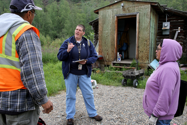 Hughes, Alaska, July 7, 2013 -- FEMA Individual Task Force Leader Shell Howard is working with this disaster survivor in the Alaskan Native owned private lands. Individuals and business owners who sustained losses in the designated area can begin applying for assistance by registering at www.disasterassistance.gov or by calling 1-800-621-FEMA (3362). Adam Dubrowa/ FEMA