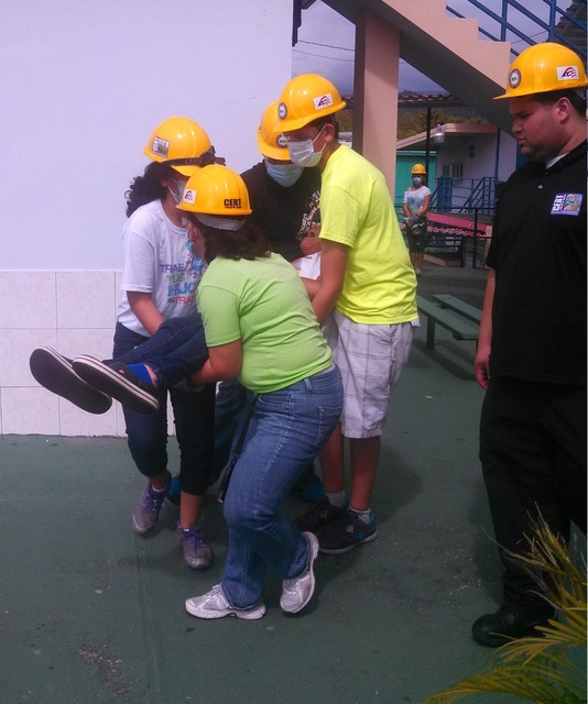 Humacao, Puerto Rico, Feb. 15, 2013 -- From left to right: Maricruz Boria Rijos, Jonix Granado, Joshua Sánchez and Gabriela Rodríguez Boria evacuate a survivor during a simulation as part of the Teen CERT training