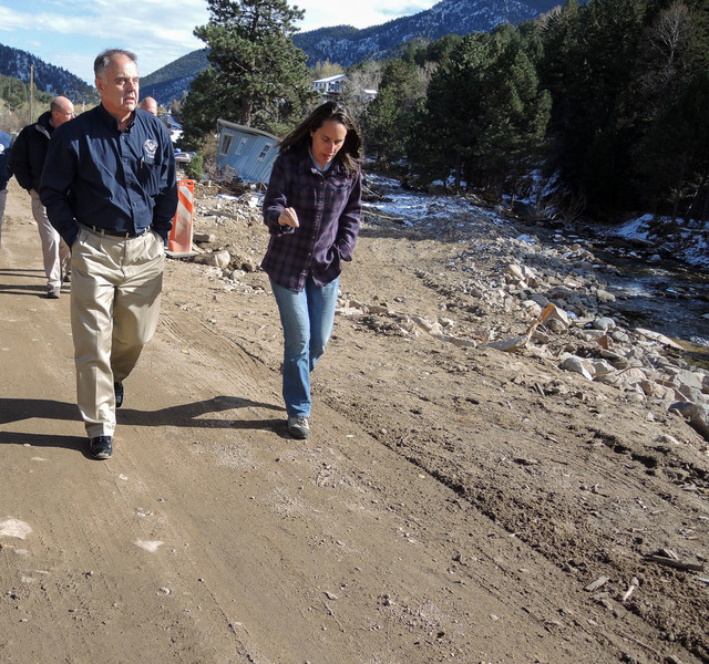 """""""Jamestown, Colo., October 30, 2013 -- Joseph Nimmich, left, FEMA Associate Administrator for the Office of Response and Recovery, walks with Tara Schoedinger, mayor of Jamestown, Colo., along the main street of Jamestown. The mountain village of about 250 people was severely damaged by the Colorado storms and flooding beginning Sept. 10. Jamestown was inaccessible for nearly a month and most of its inhabitants are temporarily living elsewhere. FEMAÂ  so far has provided more than $50 million in assistance to individuals and families in 11 counties declared for major disaster aid. Photo by James Stephenson/FEMA"""""""