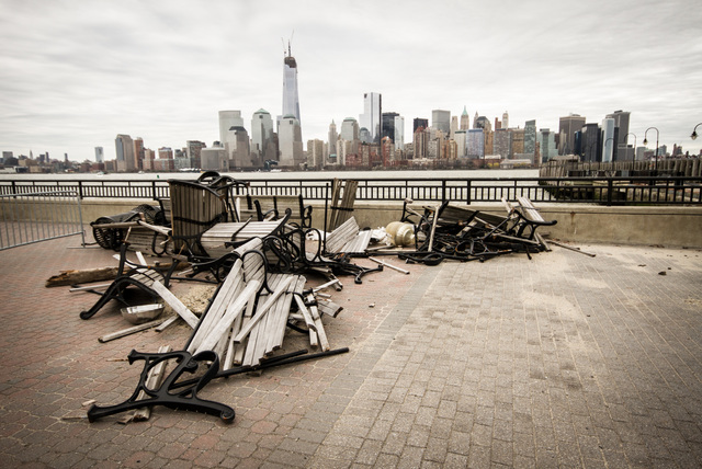 Jersey City, N.J., April 18, 2013 -- Park benches from the Central Railroad Terminal of New Jersey at Liberty State Park were collected and piled after the park was substantially damaged from Hurricane Sandy. Although ferry rides to Ellis Island and the Statue of Liberty have been suspended, sections of the park are still opened for visitors. Rosanna Arias/FEMA