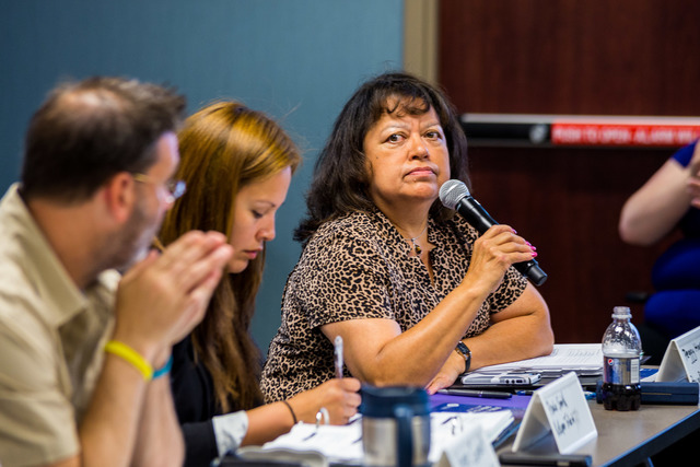 Kansas City, Mo., June 4, 2014 --  Peggy Houston, General Manager of Tribal Operations at Prairie Band Potawatomi Nation, prepares to ask a question during a Tribal Summit. Tribal leaders from Nebraska, Kansas, Iowa and Missouri are getting together at FEMA Region VII for three days to help better prepare for potential disasters in the future. (Photo by Steve Zumwalt FEMA)