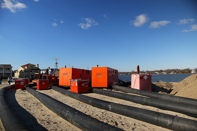 Lake Como, N.J., Jan. 17, 2013 -- After Hurricane Sandy flooded freshwater lake Como with salt water, city officials are pumping the saltwater incursion back into the Atlantic using powerful generators and vacuum hoses. FEMA Public Assistance category A debris removal is implemented to fund the operation and restore the lake to its previous fresh water state. Adam DuBrowa/ FEMA