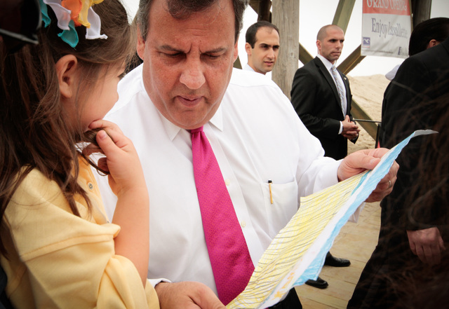 Lavallette, N.J., May 20, 2013 --Keira Fester, age six, of Sand Dollar Restaurant presents Gov. Christie with a drawing of the Lavallette boardwalk at the grand opening ceremony of the new boardwalk.  After Hurricane Sandy destroyed almost the entire boardwalk six months ago, Gov. Christie hopes that his visit will get the word out about businesses and the shore coming back for Memorial Day. Rosanna Arias/FEMA