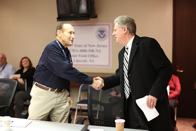 Lincroft, N.J., Jan. 7, 2013 -- FEMA Federal Coordinating Officer (FCO) Michael J. Hall welcomes Congressman Frank Pallone (D) to a briefing at the Joint Field Office regarding the recovery efforts associated with hurricane Sandy. The Congressional Affairs Division is the Federal Emergency Management Agency's primary liaison with the United States Congress. Our mission is to proactively engage and communicate with Members of Congress and their staffs to build strong working relationships that will advance the agency's legislative and emergency management priorities. Adam DuBrowa/ FEMA